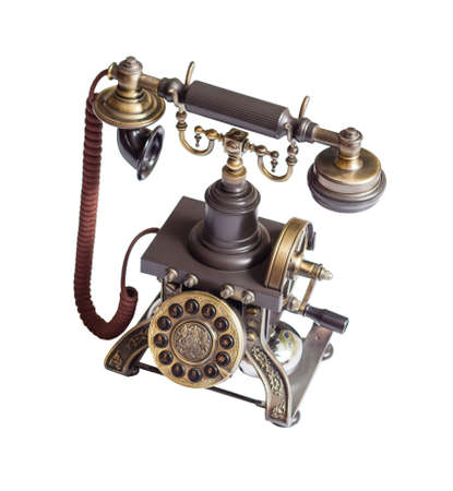 Decorated retro vintage metal telephone isolated on white background photo