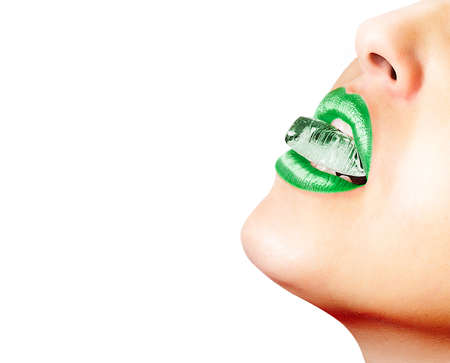 Closeup of sensual lips with green lipstick and an ice cube photo
