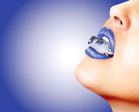 Closeup of sensual lips with blue lipstick and an ice cube photo