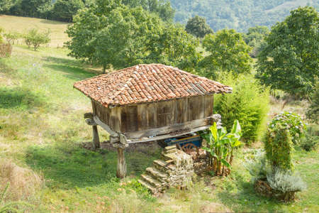 granary: View of typical granary of Asturias, in Spain, raised by stone pillars and known as  horreo  Stock Photo