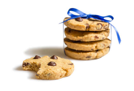 Closeup of homemade chocolate chip cookies tied with blue ribbon, isolated on white background photo