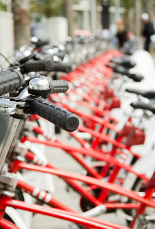 bike parking: Red bicycles parked in a row on the street, in Barcelona, Spain