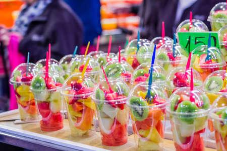 ramblas: Closeup of set packed slice of fresh fruits in the famous La Boqueria market, in Ramblas street, Barcelona, Spain