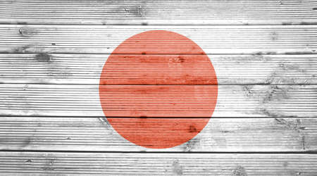 a wonderful world: Natural wood planks texture background with the colors of the flag of Japan