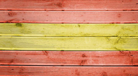 flag spain: Natural wood planks texture background with the colors of the flag of Spain Stock Photo