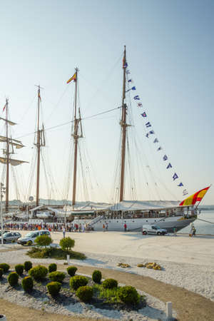 oscar niemeyer: AVILES, SPAIN - JULY 09  Spanish Navy Ship Juan Sebastian Elcano, the training ship of spanish army, docked in the port beside of Niemeyer Cultural Center, on July 09, 2013, in Aviles, Spain Editorial