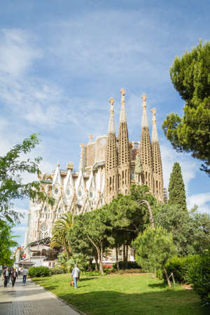 initiated: BARCELONA, SPAIN - JUNE 01 View of the Sagrada Familia cathedral, designed by Antoni Gaudi, in Barcelona, Spain, on June 01, 2013  It is a church with a modernist architecture, initiated in 1882, and still under construction Editorial