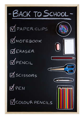 Checklist of school supplies over blackboard background photo