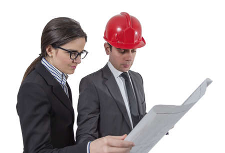 revising: Couple of architects revising a house project plan
