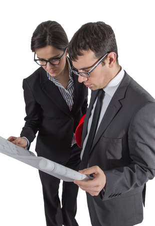 revising: Couple of architects revising a house project plans, isolated on white background Stock Photo