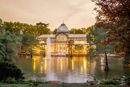 Buen Retiro park lake in Madrid with the famous crystal palace on background