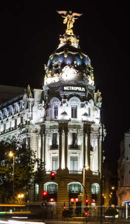 View of famous Metropolis building in Gran Via street at night, in Madrid, Spain photo