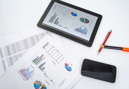 technology market: Modern workplace with digital tablet, smartphone and chart documents Stock Photo