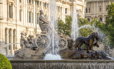 Famous Cibeles fountain at center square between Paseo del Prado and Alcala street in Madrid, Spain