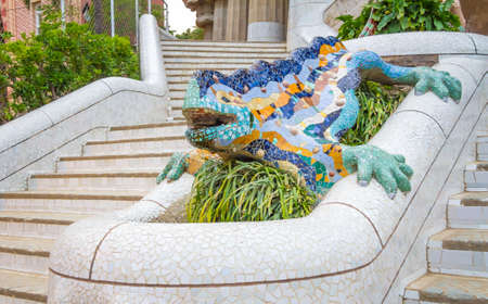 Colorful mosaic ceramic dragon over the fountain of park Guell, designed by Antonio Gaudi in Barcelona, Spain photo
