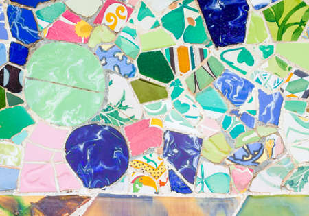 trencadis: Famous colorful ceramic mosaics detail, designed by Antonio Gaudi and better known as  trencadis   Located in the park Guell of Barcelona, Spain Stock Photo