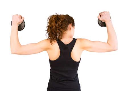 muskeltraining: R�ckansicht des sch�nen jungen M�dchen heben Hantel Scheiben in einer Muskeltraining sesion isoliert auf wei�em Hintergrund Lizenzfreie Bilder