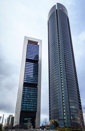 cuatro: MADRID, SPAIN - MARCH 10, 2013: Cuatro Torres Business Area (CTBA). View of Bankia Tower and PwC Tower skyscrapers
