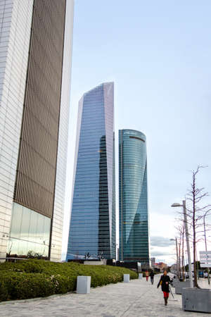 cuatro: MADRID, SPAIN - MARCH 10, 2013: Cuatro Torres Business Area (CTBA). View of Bankia Tower, Glass Tower and Space Tower skyscrapers Editorial