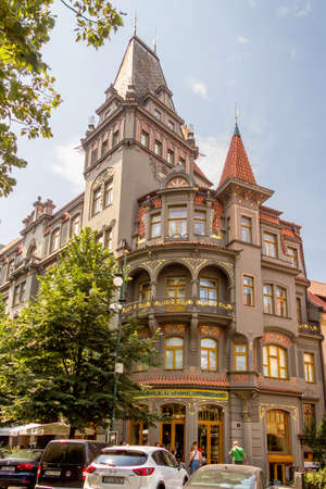 shul: PRAGUE, CZECH REPUBLIC - JULY 17, 2014: People walking in front of the Old Synagogue restaurant, in the Josefov district. The building was built in a beautiful curved Art Nouveau style.
