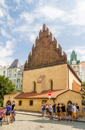 shul: PRAGUE, CZECH REPUBLIC - JULY 17, 2014: Tourists in front of the Old New Synagogue, in the Josefov district. The building its the first gothic building of Prague, finished in 1270.