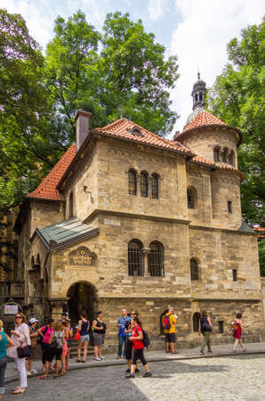 jewish quarter: PRAGUE, CZECH REPUBLIC - JULY 17, 2014: Tourists in front of the Jewish Ceremonial Hall, in the Josefov district. The building was finished in 1912 and its a part of the Jewish Museum.