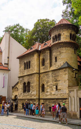 shul: PRAGUE, CZECH REPUBLIC - JULY 17, 2014: Tourists in front of the Jewish Ceremonial Hall, in the Josefov district. The building was finished in 1912 and its a part of the Jewish Museum.