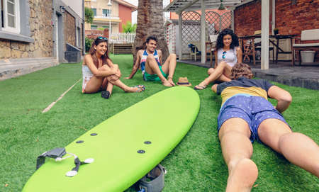 people having fun: Group of young people having fun in a summer surf class outdoors. Holidays leisure concept.