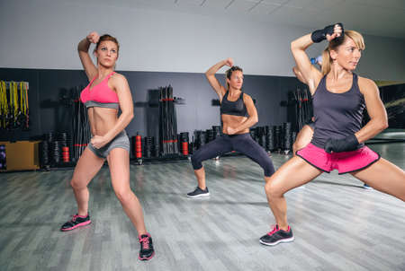combat: Group of people in a hard boxing training on fitness center Stock Photo