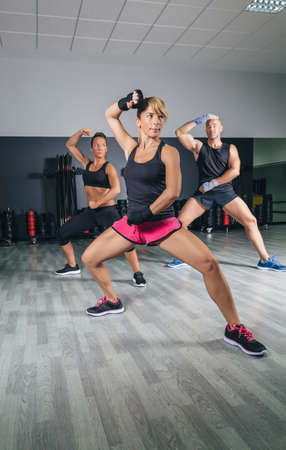 Group of people in a hard boxing training on fitness center Foto de archivo
