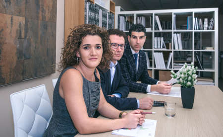 negotiating: Executive team sitting at the negotiating table in headquarters