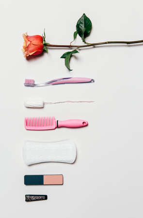 feminine background: Composition of feminine intimate hygiene set over white background. View from above.