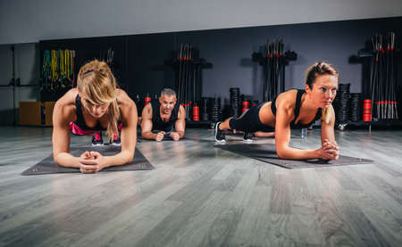 push ups: People doing push ups in fitness class on sports center