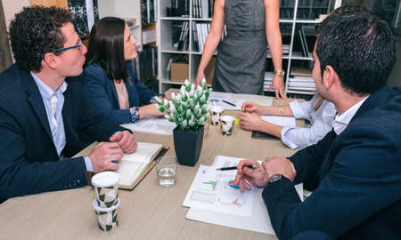 real leader: Teamwork in a business meeting on headquarters