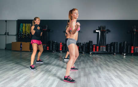 Women training boxing in a fitness center photo