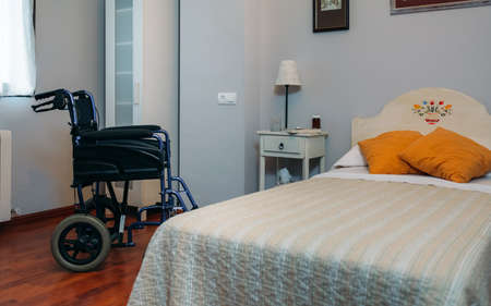 Cozy furnished empty clinic room with wheelchair Stock fotó