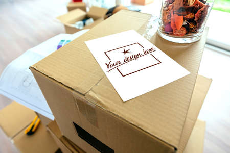 Detail of note over stack of moving boxes. Customizable note design Banco de Imagens