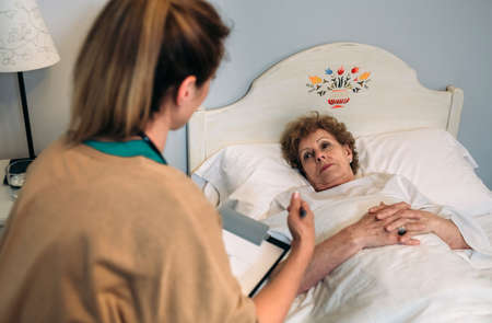 Female doctor explaining the treatment to a senior patient