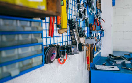 Detail of motorcycle workshop tools board and work bench Archivio Fotografico