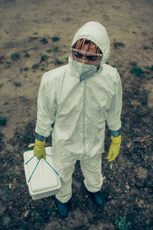 Man with mask, glasses and bacteriological protection suit Stockfoto