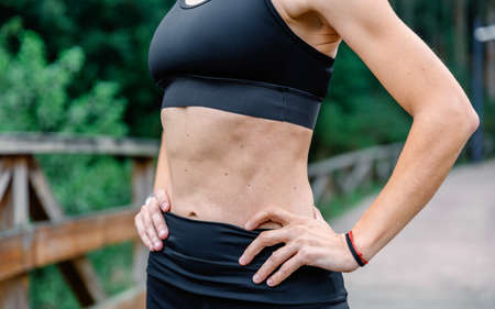 Unrecognizable athlete woman with sportswear posing outdoors Reklamní fotografie