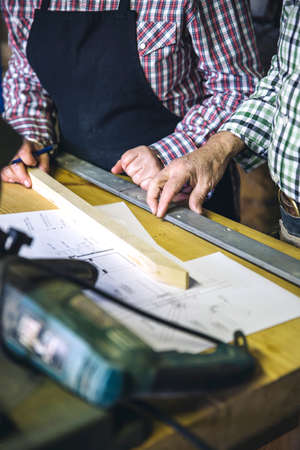 Unrecognizable senior couple working in a carpentry workshop