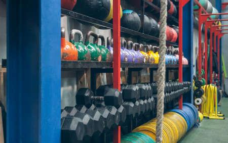Shelves with sports equipment inside a gym Archivio Fotografico