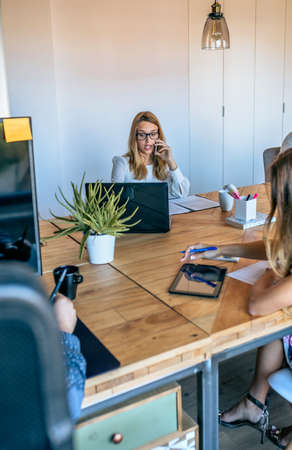 Young people working in a coworking office