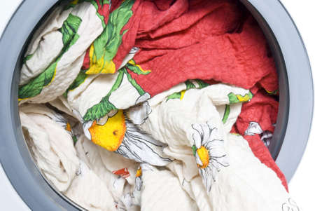 Color bed-clothes in the washing machine photo