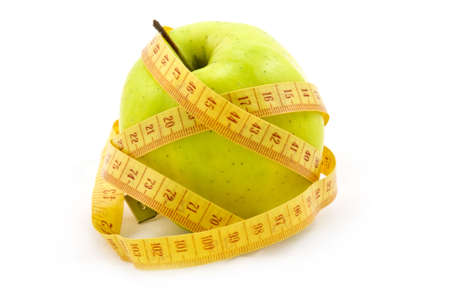 Green apple with a measure tape isolated on white background Stock Photo - 4705673
