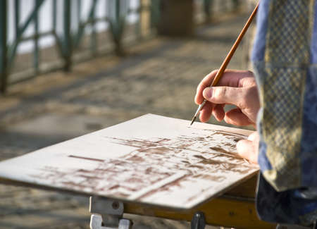 quay: The artist makes the sketch on quay in the center of Prague