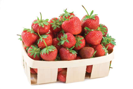 Basket of farm fresh strawberries isolated on white background photo