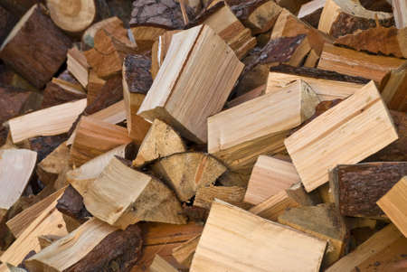 Pile of chopped fire-wood photo