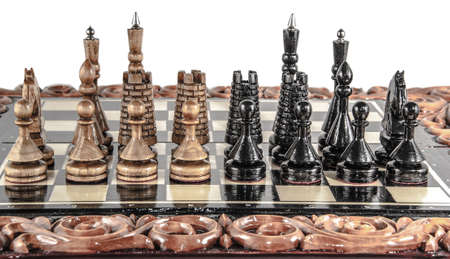 chessboard: wooden chessboard handmade. woodcarving. game of chess